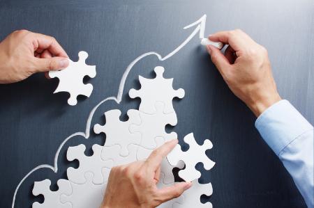 Maintaining performance improvement momentum represented by building upward trending puzzle. Credit: https://www.istockphoto.com/portfolio/tadamichi