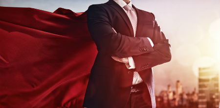 Leader in business suit with a super-hero cape