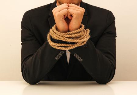 Business man with hands tied. Credit https://www.istockphoto.com/portfolio/studio4pic