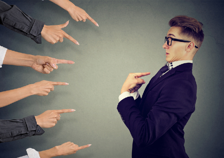 Fingers pointing at man holding him accountable. Credit: https://www.istockphoto.com/portfolio/siphotography