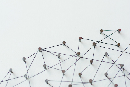 Network of pins linked by string