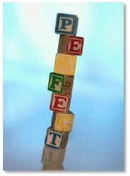 """tower of building blocks spelling out """"perfect"""""""